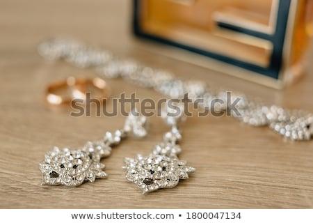 jegygyűrűk · pár · bokeh · szeretet · virág · szív - stock fotó © ruslanshramko