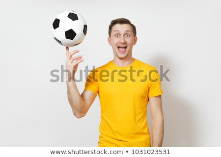 Stock photo: young man spinning ball on finger