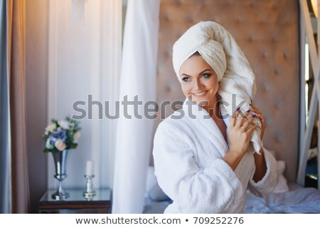 Pretty young woman with towel on head Stock photo © deandrobot