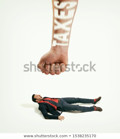 Small businessman shooting giant businessman Сток-фото © ra2studio