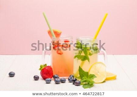 Mason jar okulary soku owoce tabeli Zdjęcia stock © dolgachov