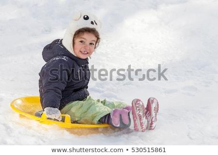 Nina nieve platillo invierno infancia trineo Foto stock © dolgachov