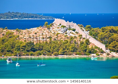 ancient wall of ostrica in grebastica bay view stock photo © xbrchx