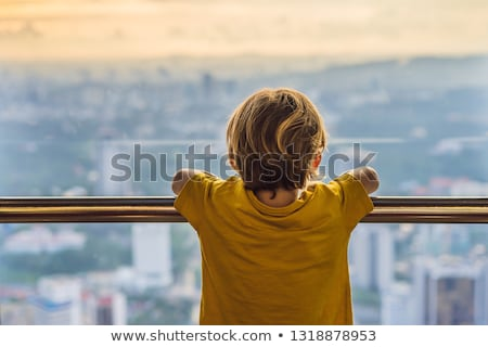 Kicsi fiú külső Kuala Lumpur városkép panorámakép Stock fotó © galitskaya
