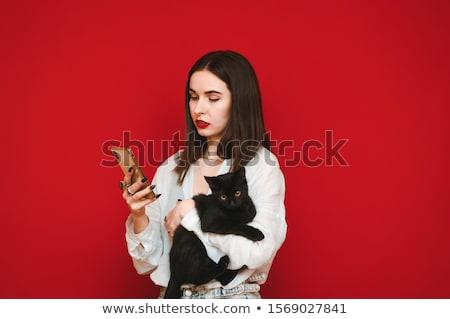 Aantrekkelijk ernstig jonge vrouw huisdier kat Stockfoto © Giulio_Fornasar