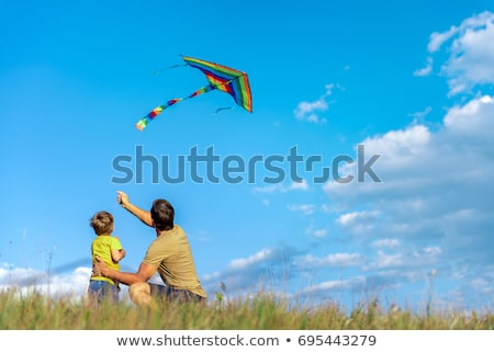 happy dad and son flying a kite together Stock photo © Lopolo