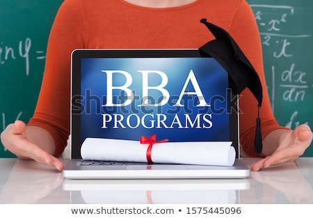 Woman Sitting With Bba Programs Text On Laptop Stock photo © AndreyPopov