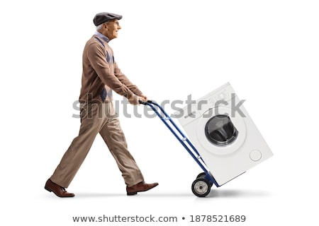 man and shopping with washer machine cart on white background. I Stock photo © ISerg
