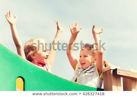Sorridere ragazza mano ragazzi parco giochi Foto d'archivio © dolgachov