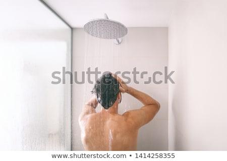 Adam duş yıkama saç şampuan Stok fotoğraf © Maridav