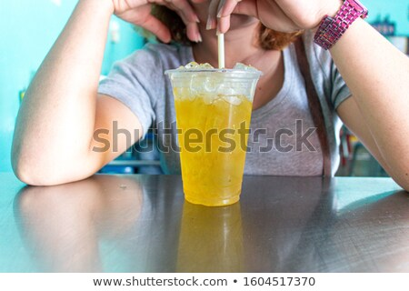gorgeous ginger woman drinking glass of water Stock photo © photography33