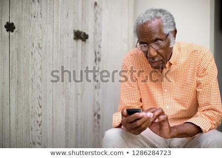 Man sitting on pillar Stock photo © photography33