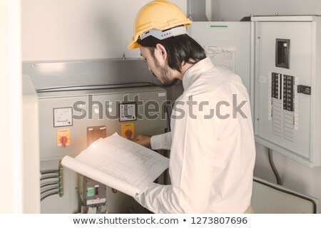 Contractor holding instruction manual Stock photo © photography33