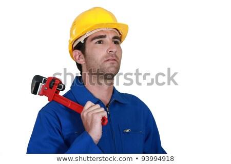 Töprengő villanyszerelő tart szabályozható csavarkulcs férfi Stock fotó © photography33
