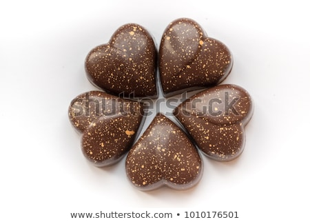 chocolate candy in heart-shaped hands Stock photo © marimorena