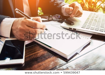 businessman writing a note stock photo © stevanovicigor