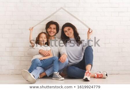 belo · sensual · mulher · sessão · parede · de · tijolos · sorrir - foto stock © aikon