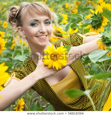perfection happy golden hair woman with flower femininity sensuality stock photo © gromovataya