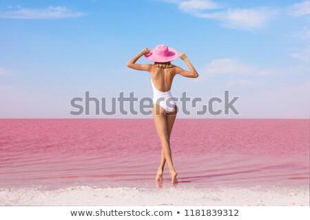 Beautiful woman in a pink bikini Stock photo © stryjek