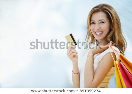 Fiatal nő tart hitelkártya bevásárlótáskák portré aranyos Stock fotó © williv
