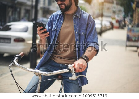 Stock photo: casual man with hat holding his sunglasses