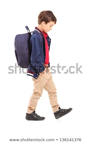 Portret triest schooljongen lopen geïsoleerd Stockfoto © ashumskiy