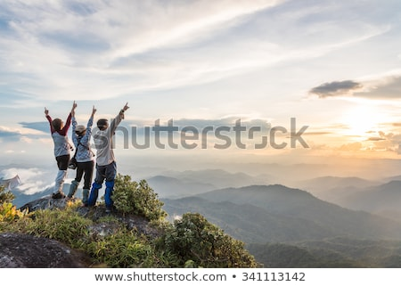 woman on a top of a mountain enjoying valley view stock photo © amok
