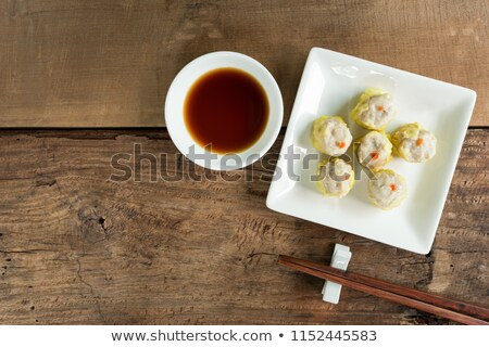 Steamed dumpling stuff serving on wooden plate Stock photo © nalinratphi