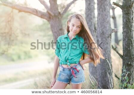 Portré aranyos lány farmer rövidnadrág hajnal Stock fotó © bezikus
