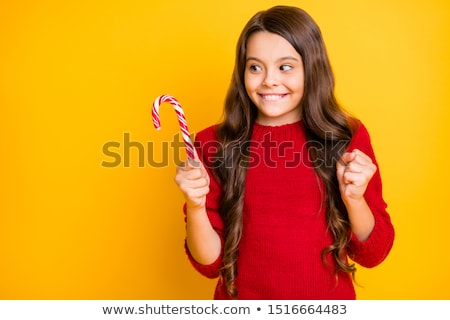 woman holding christmas candy canes stock photo © hasloo