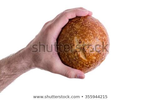 Clean male hand grasping a sourdough bun Stock photo © ozgur