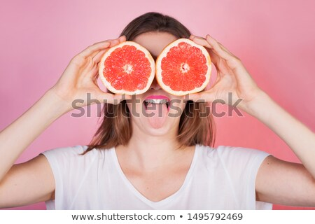 Funny juguetón mujer agrios frutas Foto stock © deandrobot
