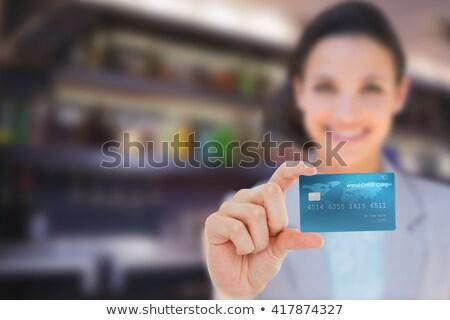 Composite image of happy businesswoman showing a creditcard Stock photo © wavebreak_media