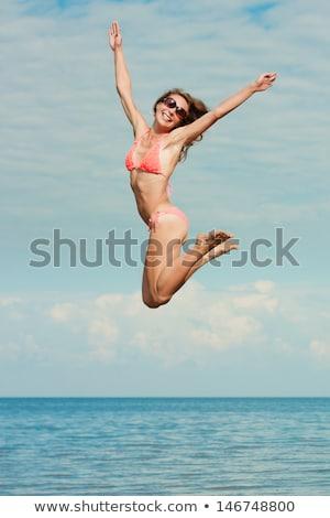 praia · óculos · de · sol · mulher · sol · sensual - foto stock © dolgachov