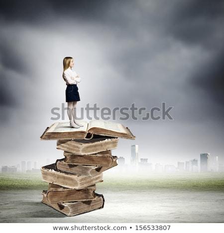 szczęśliwy · dziewczynka · ciężki · książek · odizolowany - zdjęcia stock © deandrobot