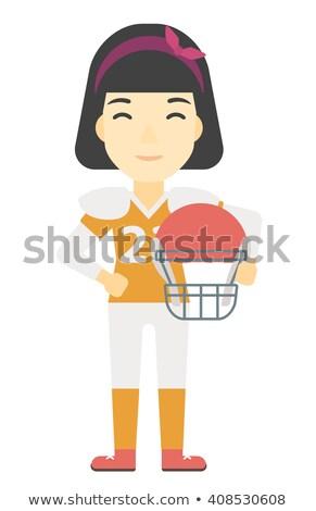 Female football player holding helmet Stock photo © LightFieldStudios