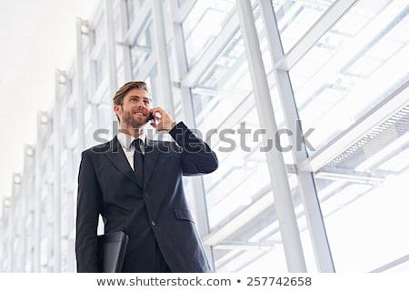 小さな · ビジネスマン · 話 · 携帯電話 · 明るい · ウィンドウ - ストックフォト © dotshock