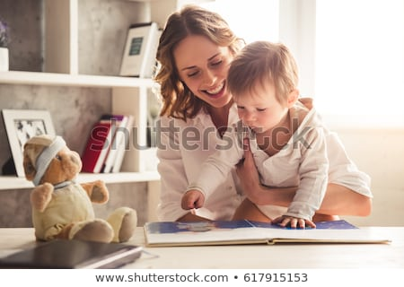smiling child boy in business suit holding books stock photo © ia_64