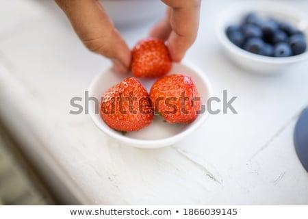 Freshly picked blueberries and raspberries on white plate Stock photo © Melnyk