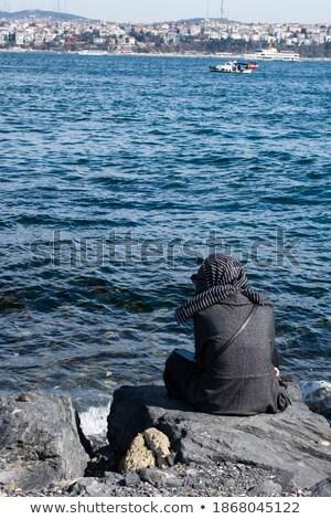 Beautiful woman sitting on boat close to the ocean beach Stock photo © Kzenon