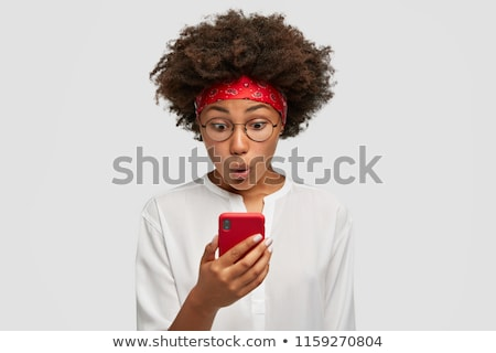 Portrait of a shocked young african woman in headband Stock photo © deandrobot