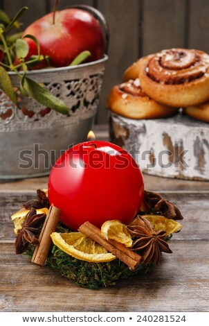 Christmas candle with candle holder made of orange with dry cloves isolated on white background. Nat Stock photo © Lady-Luck