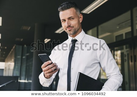 Kép üzletember hivatalos öltöny áll kívül Stock fotó © deandrobot