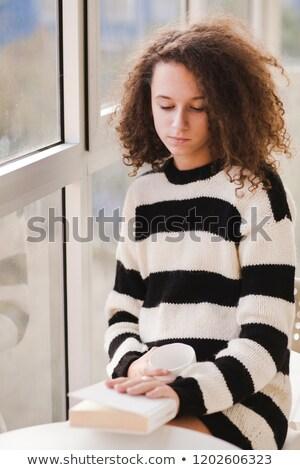 Kıvırcık saçlı genç kız çay kitap ev portre Stok fotoğraf © boggy