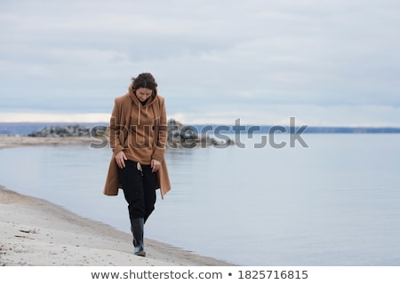güzel · bir · kadın · sıcak · kış · elbise · genç - stok fotoğraf © deandrobot