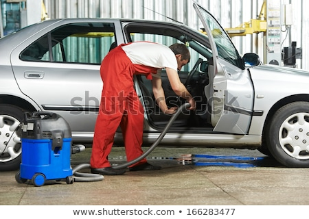 Stock photo: Mechanic Vacuuming The Car At The Garage