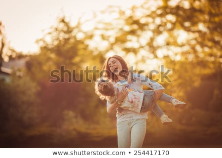 happy mother and little daughter at autumn park stock photo © dolgachov
