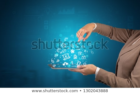 Stock photo: Hand holding tablet with chalk drawn symbols above