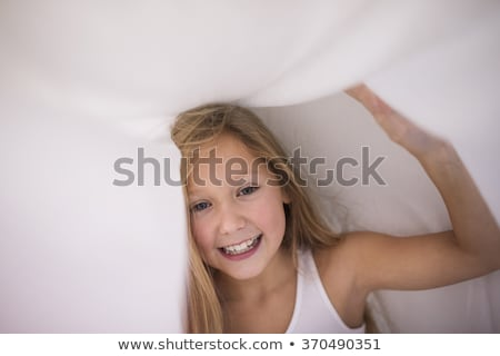 A little girl in bed below the covers Stock photo © Lopolo