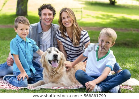 Family with two boys and pets stock photo © colematt